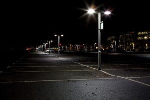 Streetlights illuminate a parking lot